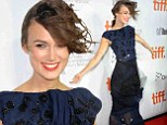 How to ruin a perfectly good look! Keira Knightley cuts a bedraggled figure in her glam gown as storms hit Toronto Film Festival