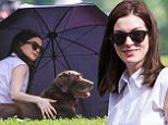 Doggy date: Anne Hathaway was joined by her pup Esmeralda between takes of The Intern in Brookyln, New York on Wednesday