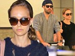 Natalie Portman makes a glum arrival at LAX as she jets in from Paris with husband Benjamin Millepied