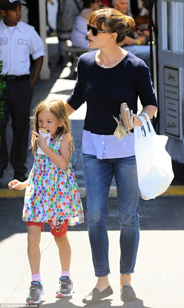 Girls day out: Jennifer Garner steps out with daughter Seraphina, one of three children with husband Ben Affleck, in Los Angeles on Thursday