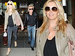 11 Sep 2014 - LONDON - UK AGEING ROCKER ROD STEWART AND HIS WIFE PENNY LANCASTER ARRIVE AT HEATHOW AFTER FLYING IN FROM LAX! BYLINE MUST READ : XPOSUREPHOTOS.COM ***UK CLIENTS - PICTURES CONTAINING CHILDREN PLEASE PIXELATE FACE PRIOR TO PUBLICATION *** **UK CLIENTS MUST CALL PRIOR TO TV OR ONLINE USAGE PLEASE TELEPHONE  44 208 344 2007**