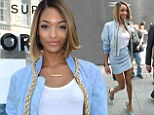 Jourdan Dunn showcases her model-esque pins in ice blue miniskirt and matching bomber jacket at London Fashion Week