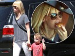 Talk about hungry work! January Jones tucks into custard doughnut... then takes her boy Xander for a stroll in Los Angeles