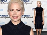 That's REALLY blonde! Michelle Williams shows off her new super peroxide bleached hairstyle at 9/11 event