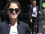 Nikki Reed is edgy chic in black coat and ripped jeans as she enjoys solo pampering session at the nail salon