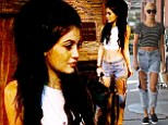 Fashion copy cats! Kylie Jenner and sister Kendall's BFF Hailey Baldwin step out in the same slashed jeans
