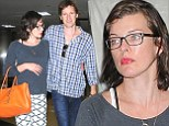 Pregnant Milla Jovovich strolls arm-in-arm with husband Paul W. S. Anderson at LAX