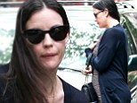 Liv Tyler fuels pregnancy rumours while showing off rounded stomach as she leaves her apartment with boyfriend Dave Gardner