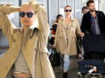 Home sweet home! Diane Kruger flashes her midriff as she and beau Joshua Jackson arrive at LAX after multi-city trip