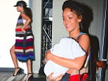 Feeling broody? Rihanna shows off her maternal side as she cradles baby cousin after photo shoot in New York