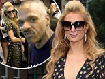 Who says money can't buy you love? Paris Hilton gets a kiss and is asked out by a homeless man after giving him some cash