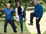 Far from Flawless! Anne Hathaway and co-star Robert De Niro playfully film outdoor Tai Chi scenes for new movie The Intern