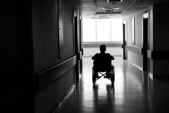 Man on wheelchair in corridor