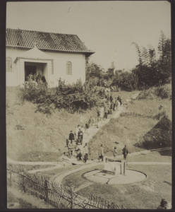 Going to church in Hoschuwan with the new well in the foreground.