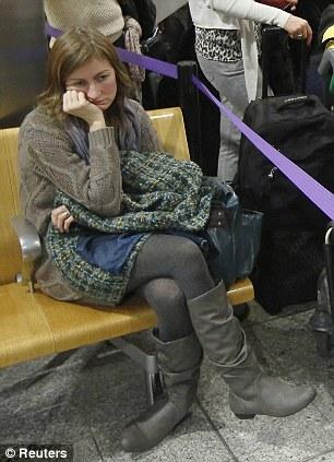 Passengers queue in Terminal 3 at Heathrow Airport