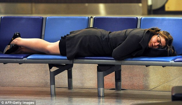 Taking a nap: A woman sleeps at London Gatwick as Britain's airports experienced delays and cancellations