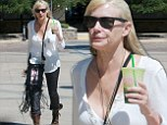 Daryl Hannah steps out alone a day after cuddling up to rocker Neil Young, who just split from his wife of over 35 years