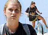 Out and about: Kesha went for a barefoot bike ride by the beach in Venice, Los Angeles on Thursday