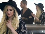 Honeymoon's over! Newlyweds Ashlee Simpson and Evan Ross jet home after whirlwind romantic trip in Bali
