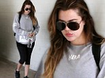 'Working on the BOOTY!': Khloe Kardashian works out for fifth day in a row... wears $250 HBA shirt while exercising her famous backside