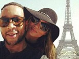 The look of love! John Legend and Chrissy Teigen can't keep their hands off each other as they pose for selfies at the Eiffel Tower