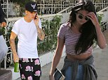 Selena Gomez and Justin Bieber step out separately in LA hours after the troubled pop star confirmed they're back together
