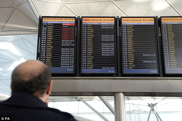 Estimates: A flight information board at London Stansted after a 'technical problem' caused delays at airports