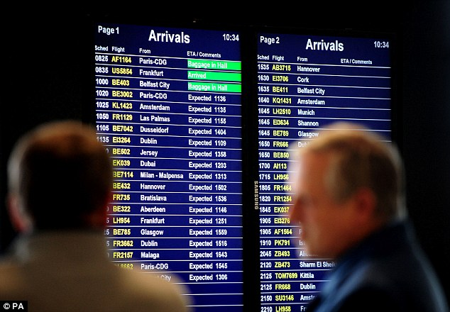 Delays galore: A flight information board at Birmingham Airport, as a 'technical problem' at the National Air Traffic Services control centre in Swanwick, Hampshire, caused delays at airports across Britain