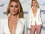 AnnaLynne McCord is pretty in just a blazer and skinny trousers as she volunteers at 9/11 charity drive