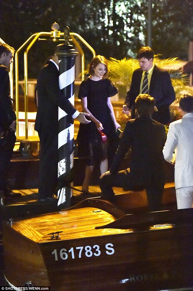 Barefoot: The actress held her red shoes in her hand as she exited the river taxi and waited for her boyfriend