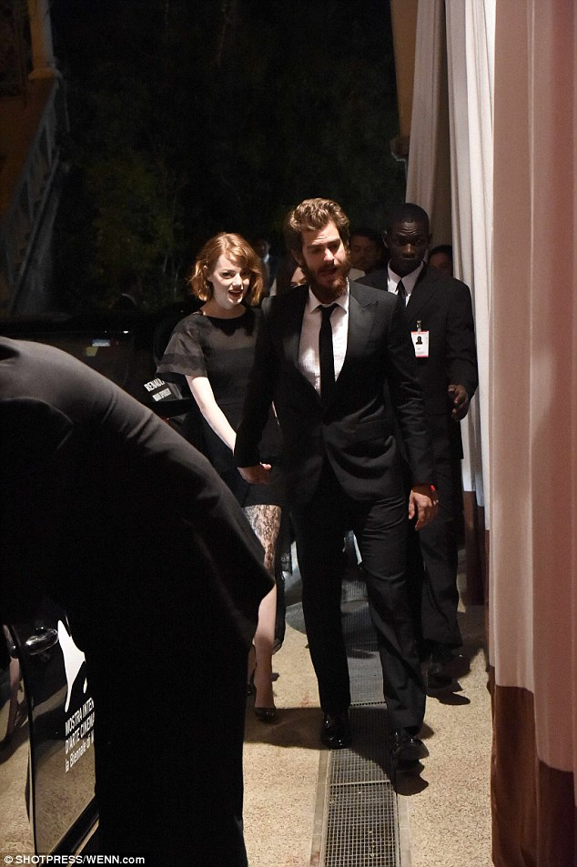 Leading the way: Lead by Andrew, Emma wore a black mini dress with a long lace skirt and her hair pinned b behind her ear