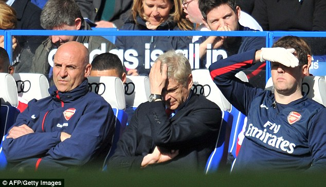 Humiliated: Arsene Wenger can't believe what he was seeing during his 1,000th match in charge of Arsenal