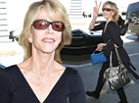 She's still got it! Jane Fonda, 76, looks flawless as she breezes through LAX in chic all-black outfit