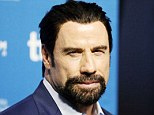 You've goatee be kidding! John Travolta sports dark wooly facial hair while attending press conference at Toronto Film Festival