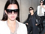 Happy homecoming? A sad Kendall Jenner returns to LA with momager Kris after successfully walking in four NYFW shows