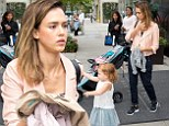 Feeling weary? Busy mom Jessica Alba juggles daughters and jackets while out and about in New York City