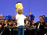"""In this photo provided by the Hollywood Bowl, the orchestra, led by conductor Thomas Wilkins in a Homer Simpson costume, performs at the world premiere of """"The Simpsons Take the Bowl"""" at the legendary concert venue Friday, Sept. 12, 2014, in Los Angeles. The program featured music, stars and reminiscences from TV's longest-running scripted show. (AP Photo/The Hollywood Bowl, Greg Grudt)"""
