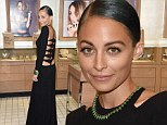 Almost cheeky! Nicole Richie nearly shows her derriere in a stunning black gown