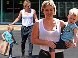 She's back! A jet-lagged Hilary Duff gets a helping hand from her littlest fan as she returns to Los Angeles from Australia
