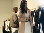 Kim Kardashian and Kanye in the store Assin looking at clothes in Paddington, Sydney.  Ref: SPL842285  130914   Picture by: Kate Dwek / Splash News  Splash News and Pictures Los Angeles: 310-821-2666 New York: 212-619-2666 London: 870-934-2666 photodesk@splashnews.com