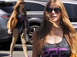 Not afraid of being noticed, is she? Sofia Vergara stands out in leopard print leggings for morning spinning class