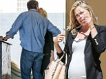 Day date! Ali Larter shows off her bump as she gets romantic with husband Hayes MacArthur on a trip to a movie matinee