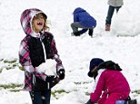 In this Thursday, Sept. 11, 2014 photo, Livingston Elementary first-grader Jesse Birky enjoys playing in the snow during recess in Cody, Wyo. A late summer snowstorm dropped 3 to 5 inches in Cody, the earliest recorded snowfall there since records were kept in 1915. Other parts of the state received up to 20 inches of snow. (AP Photo/The Cody Enterprise, Raymond Hillegas) POWELL TRIBUNE OUT