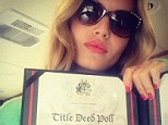 Lady Jagger: Being the daughter of Sir Mick was not enough for model Georgia May, who posed with a certificate apparently showing that she has acquired a title and will now be known officially as Lady Georgia May Jagger