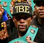 LAS VEGAS, NV - SEPTEMBER 13:  Floyd Mayweather Jr. celebrates his unanimous decision victory against Marcos Maidana during their WBC/WBA welterweight title fight at the MGM Grand Garden Arena on September 13, 2014 in Las Vegas, Nevada.  (Photo by Al Bello/Getty Images)