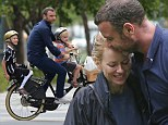 The family that plays together! Liev Schreiber plants tender kiss on Naomi Watts as the couple spend time with their sons in the park