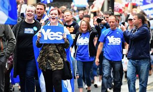 Yes: Supporters of independence marching through the streets of Glasgow during a demonstration yesterday