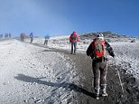 AX701K trekkers approaching the summit of Mount Kilimanjaro in Northern Tanzania, the highest Mountain In Africa.. Image shot 2008. Exact date unknown.