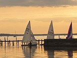 Sundowner: The sunset at Poole Harbour, where the Nomad moors up for the night