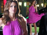 Gorgeous in pink! Cindy Crawford, 48, shows off her supermodel moves in flowing fuchsia dress while filming new commercial